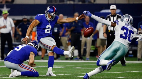 FILE - In this Sept. 10, 2017, file photo, New York Giants' Aldrick Rosas (2) kicks a field goal as Dallas Cowboys cornerback Anthony Brown (30) defends in the second half of an NFL football game, in Arlington, Texas. Brad Wing (9) holds at bottom left. Making his NFL debut wasn't the only exciting thing that happened to Rosas this past weekend. Hours before the Sunday night game in Dallas, Rosas' girlfriend, Tiffany Lopez, gave birth to their first child in California. He watched the birth on his phone at 4:15 a.m. CDT after a four-hour labor. (AP Photo/Ron Jenkins, File)