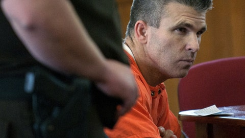 FILE - In this Oct. 3, 2013, file photo, Former Major League Baseball player Chad Curtis appears in court for his sentencing in Hastings, Mich. Two of four young women who alleged Curtis inappropriately touched them have settled a federal civil lawsuit against him. Terms of the settlements weren't included in court documents filed Thursday, Sept. 14, 2017,  and damages are expected to be determined Oct. 12. Portions of the case against Curtis involving the other two young women are pending. (Chris Clark/The Grand Rapids Press via AP, File)