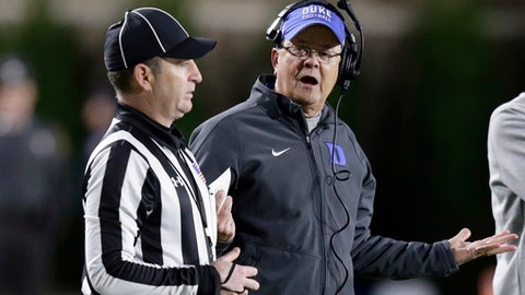 FILE - In this Thursday, Nov. 10, 2016 file photo, Duke coach David Cutcliffe speaks with an official during the second half of the team's NCAA college football game against North Carolina in Durham, N.C. Duke knows the danger of assuming an easy victory against an opponent with a poor record and some befuddling losses in other words, a team like Baylor. Not long ago, the Blue Devils were the ones being looked past. Duke plays host to the Bears on Saturday, Sept. 16, 2017 hoping to earn its first 3-0 start since 2014. (AP Photo/Gerry Broome, File)