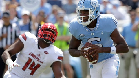 FILE - In this Saturday, Sept. 9, 2017, file photo, Louisville's Drew Bailey (14) chases North Carolina quarterback Brandon Harris (6) during the second half of an NCAA college football game in Chapel Hill, N.C. North Carolina takes on Old Dominion on Saturday. (AP Photo/Gerry Broome, File)