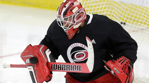 Carolina Hurricanes goalie Scott Darling blocks a shot during the NHL hockey team's training camp in Raleigh, N.C., Friday, Sept. 15, 2017. (AP Photo/Gerry Broome)