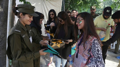 Pakistani police officers check cricket spectators arrive to watch the final match between Pakistan and World XI at Gaddafi stadium in Lahore, Pakistan, Sept. 15, 2017. (AP Photo/K.M. Chaudary)