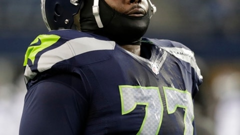Seattle Seahawks defensive tackle Ahtyba Rubin wears a face mask in cold temperatures before an NFL football NFC wild card playoff game against the Detroit Lions, Saturday, Jan. 7, 2017, in Seattle. (AP Photo/Elaine Thompson)