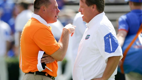 FILE - In this Sept. 26, 2015, file photo, Tennessee head coach Butch Jones, left, and Florida head coach Jim McElwain meet at midfield before an NCAA college football game between Florida and Tennessee in Gainesville, Fla. Two weeks after losing a season opener for the first time in 28 years, the Gators are facing the possibility of starting 0-2 for the first time since 1971 when they host Tennessee on Saturday. (AP Photo/John Raoux, File)