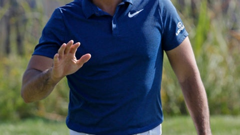Jason Day waves to the crowd after he made a birdie putt on the third hole during the second round of the BMW Championship golf tournament at Conway Farms Golf Club, Friday, Sept. 15, 2017, in Lake Forest, Ill. (AP Photo/Nam Y. Huh)