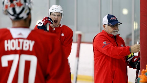 Washington Capitals defenseman Dmitry Orlov, center, yawns as head coach Barry Trotz, right, explains the next drill during practice at their NHL hockey practice facility, Friday, Sept. 15, 2017 in Arlington, Va. (AP Photo/Alex Brandon)
