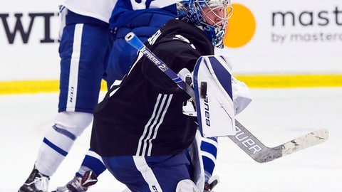 Toronto Maple Leafs goalie Frederik Andersen makes a blocker save during NHL hockey training camp in Niagara Falls, Ontario, Friday, Sept. 15, 2017.  (Nathan Denette/The Canadian Press via AP)