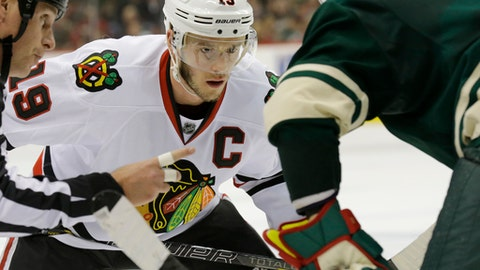 FILE - In this May 6, 2014, file photo, Chicago Blackhawks center Jonathan Toews (19) waits for the puck to drop during a face-off against the Minnesota Wild in the second period of Game 3 of an NHL hockey second-round playoff series in St. Paul, Minn.  Coming off perhaps his worst season, Toews gets back to work with the Blackhawks. The captain had just 21 goals last year and Chicago was swept in the first round of the playoffs.  (AP Photo/Ann Heisenfelt, File)
