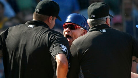 Chicago Cubs catcher Willson Contreras, center, shouts at home plate umpire Jordan Baker, left, as crew chief Bill Welke listens during the fifth inning of a baseball game against the St. Louis Cardinals, Friday, Sept. 15, 2017, in Chicago. (AP Photo/Charles Rex Arbogast)