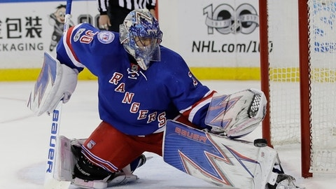 FILE - In this May 4, 2017, file photo, New York Rangers goalie Henrik Lundqvist (30), of Sweden, stops a shot on the goal during the first period of Game 4 of an NHL hockey Stanley Cup second-round playoff series against the Ottawa Senators in New York. The New York Rangers are set to start practicing at training camp this weekend. (AP Photo/Frank Franklin II, File)