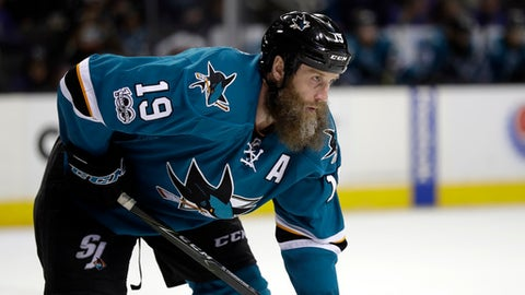 FILE - In this March 28, 2017, file photo, San Jose Sharks center Joe Thornton (19) gets set during a face-off during the third period of an NHL hockey game against the New York Rangers in San Jose, Calif. While the Sharks lost Marleau in free agency, they did manage to keep Thornton by giving him a one-year, $8 million contract despite dwindling production last season and offseason knee surgery.  (AP Photo/Marcio Jose Sanchez, File)