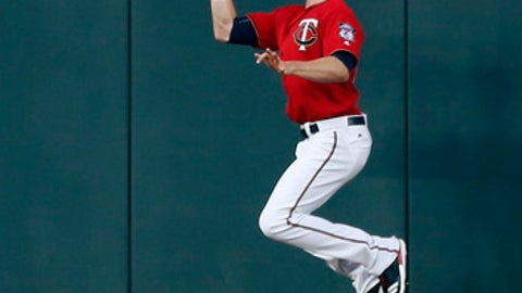 Minnesota Twins right fielder Max Kepler jumps to catch a ball hit by Toronto Blue Jays' Richard Urena during the first inning of a baseball game Friday, Sept. 15, 2017, in Minneapolis. (AP Photo/Jim Mone)