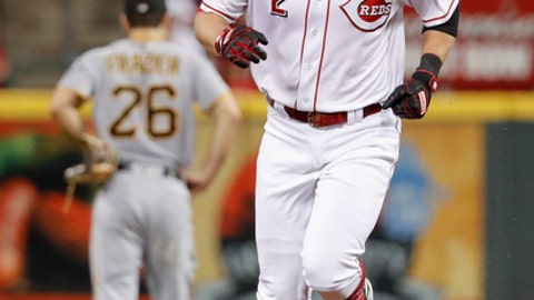 Cincinnati Reds' Zack Cozart runs the bases on his second solo home run off Pittsburgh Pirates starting pitcher Chad Kuhl, during the fifth inning of a baseball game, Friday, Sept. 15, 2017, in Cincinnati. (AP Photo/John Minchillo)