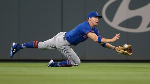 New York Mets center fielder Brandon Nimmo makes a diving catch on a fly ball by Atlanta Braves' Lane Adams during the fifth inning of a baseball game Friday, Sept. 15, 2017, in Atlanta. A run scored on the play. (AP Photo/John Bazemore)