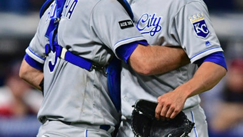 Kansas City Royals catcher Drew Butera, left, and relief pitcher Mike Minor, right, celebrate after they defeated the Cleveland Indians in a baseball game, Friday, Sept. 15, 2017, in Cleveland. (AP Photo/David Dermer)