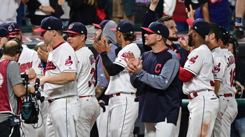 Cleveland Indians fans applaud the fans after the ninth inning of a baseball game against the Kansas City Royals, Friday, Sept. 15, 2017, in Cleveland. (AP Photo/David Dermer)