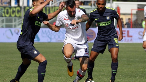Crotone's Bruno Martella, center, is challenged by Inter MiIan's Joao Mario, right, and Danilo D'Ambrosio, during a Serie A soccer match between Crotone and Inter Milan at the Ezio Scida Stadium in Crotone, Italy, Saturday, Sept. 16, 2017. (Albano Angilletta/ANSA via AP)
