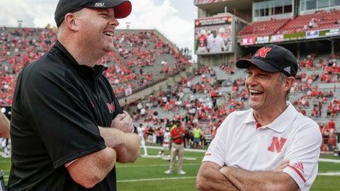 Northern Illinois head coach Rod Carey, left, jokes with Nebraska head coach Mike Riley before an NCAA college football game in Lincoln, Neb., Saturday, Sept. 16, 2017. (AP Photo/Nati Harnik)