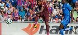 Late Paulinho goal keeps Barcelona perfect in Spain