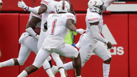 Northern Illinois linebacker Jawuan Johnson, right, celebrates after scoring a touchdown on an interception of a throw by Nebraska quarterback Tanner Lee, during the first half of an NCAA college football game in Lincoln, Neb., Saturday, Sept. 16, 2017. (AP Photo/Nati Harnik)