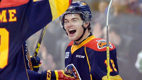 FILE - In this Jan. 31, 2016, file photo, Erie Otters right wing Alex DeBrincat celebrates with teammates after scoring against the Mississauga Steelheads during the third period of their OHL hockey game at Erie Insurance in Erie, Pa. DeBrincat piled up huge numbers with the Erie Otters of the Ontario Hockey League last season. Now one of the NHL's top prospects is getting a chance to make the Chicago Blackhawks.  (Andy Colwell/Erie Times-News via AP, File)