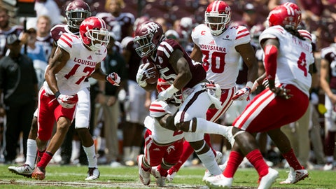 Texas A&M running back Kendall Bussey (25) avoids a tackle by Louisiana-Lafayette defensive back Corey Turner (6) during the third quarter of an NCAA college football game Saturday, Sept. 16, 2017, in College Station, Texas. (AP Photo/Sam Craft)