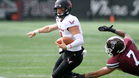 Eastern Washington quarterback Gage Gubrud evades the tackle attempt of Fordham's Noah Fitzgerald (7) during the first half an NCAA college football game, Saturday, Sept. 16, 2017, in the Bronx borough of New York. (Jon Lambert/Eastern Washington University via AP)