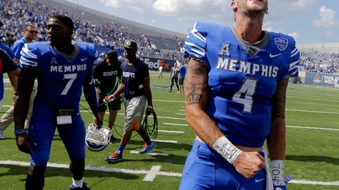 Memphis quarterback Riley Ferguson (4) lets out a yell as he leaves the field after Memphis beat UCLA 48-45 in an NCAA college football game Saturday, Sept. 16, 2017, in Memphis, Tenn. (AP Photo/Mark Humphrey)