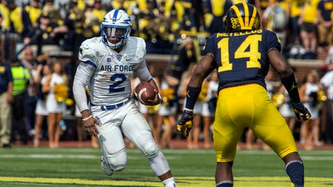Air Force quarterback Arion Worthman (2) rushes into coverage defended by Michigan defensive back Josh Metellus (14) in the second quarter of an NCAA college football game in Ann Arbor, Mich., Saturday, Sept. 16, 2017. (AP Photo/Tony Ding)