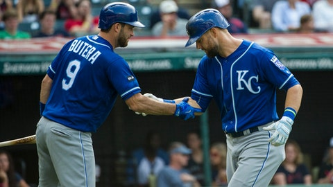 Kansas City Royals' Alex Gordon, right, is greeted by Kansas City Royals' Drew Butera after hitting a home run off Cleveland Indians starting pitcher Carlos Carrasco during the third inning of a baseball game in Cleveland, Saturday, Sept. 16, 2017. (AP Photo/Phil Long)