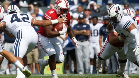 Wisconsin running back Chris James (5) brakes a tackle from BYU linebacker Johnny Tapusoa (42) in the first half during an NCAA college football game, Saturday, Sept. 16, 2017, in Provo, Utah. (AP Photo/Kim Raff)