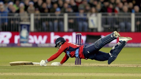 England's Jonny Bairstow dives in to survive a run out, during their T20 match at the Emirates Riverside stadium in Durham, England, Saturday Sept. 16, 2017.  (Richard Sellers/PA via AP)