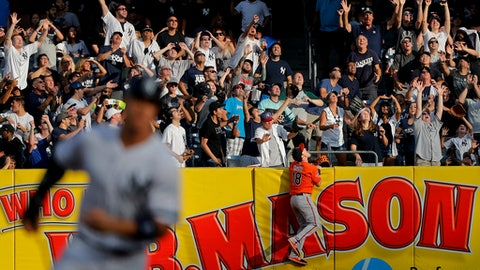 Baltimore Orioles right fielder Austin Hays (18) climbs the wall looking for a three-run home run ball hit by New York Yankees' Didi Gregorius during the third inning of a baseball game, Saturday, Sept. 16, 2017, in New York. (AP Photo/Julie Jacobson)