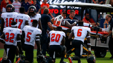Mercer players watch as Auburn offensive lineman Darius James (78) is carted off after an injury during the first half of an NCAA college football game, Saturday, Sept. 16, 2017, in Auburn, Ala. (AP Photo/Butch Dill)