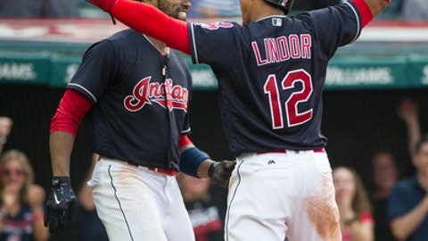 Cleveland Indians' Francisco Lindor greets Austin Jackson after Jackson scored on a throwing error by Kansas City Royals' Drew Butera during the sixth inning of a baseball game in Cleveland, Saturday, Sept. 16, 2017. (AP Photo/Phil Long)