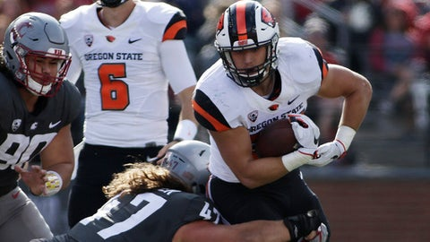 Oregon State running back Ryan Nall (34) avoids a tackle by Washington State linebacker Peyton Pelluer (47) during the first half of an NCAA college football game in Pullman, Wash., Saturday, Sept. 16, 2017. (AP Photo/Young Kwak)