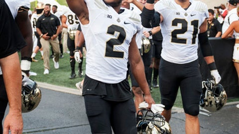 Purdue's Da'Wan Hunte, left, and Markus Bailey, right, celebrate with fans as they walk off the field after beating Missouri 35-3 in an NCAA college football game Saturday, Sept. 16, 2017, in Columbia, Mo. (AP Photo/L.G. Patterson)