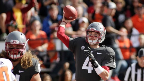 Washington State quarterback Luke Falk (4) throws a pass during the first half of an NCAA college football game against Oregon State in Pullman, Wash., Saturday, Sept. 16, 2017. (AP Photo/Young Kwak)