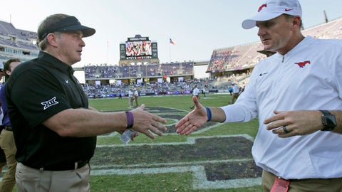 TCU head coach Gary Patterson, left, shakes hands with SMU head coach Chad Morris after an NCAA college football game in Fort Worth, Texas, Saturday, Sept. 16, 2017. TCU won 56-36. (AP Photo/LM Otero)