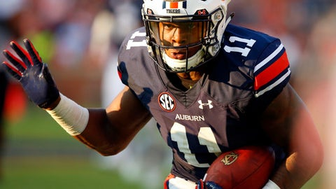 Auburn wide receiver Kyle Davis (11) carries the ball after a reception during the second half of an NCAA college football game against Mercer, Saturday, Sept. 16, 2017, in Auburn, Ala. Auburn won 24-10. (AP Photo/Butch Dill)