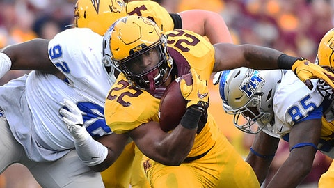 Minnesota running back Kobe McCrary runs against Middle Tennessee Blue Raiders in the second half of an NCAA college football game Saturday, Sept. 16, 2017, in Minneapolis. (AP Photo/John Autey)