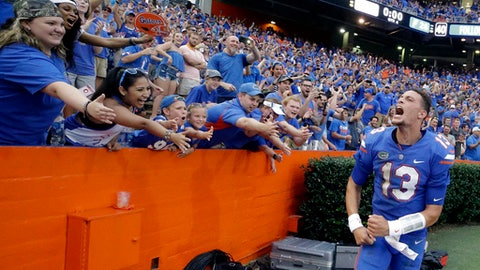 Florida quarterback Feleipe Franks (13) celebrates with fans after he threw a 63-yard touchdown pass as time expired to defeat Tennessee 26-20 in an NCAA college football game, Saturday, Sept. 16, 2017, in Gainesville, Fla. (AP Photo/John Raoux)