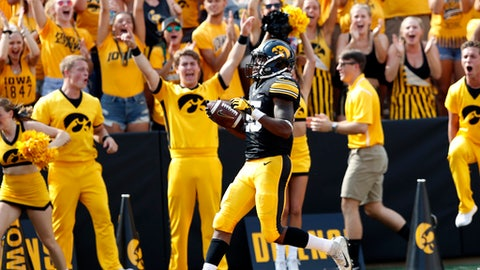 Iowa running back Akrum Wadley celebrates as he crosses the goal line on a 68-yard reception during the first half of an NCAA college football game against North Texas, Saturday, Sept. 16, 2017, in Iowa City, Iowa. (AP Photo/Charlie Neibergall)