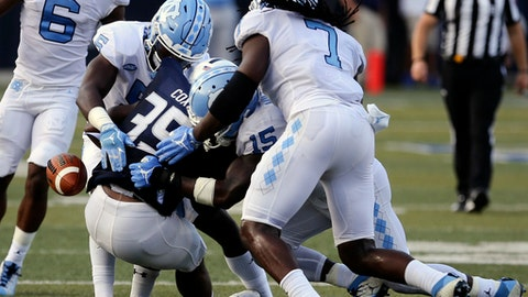 North Crolina defenders Patrice Rene (5), Donnie Miles (15) and Jonathan Smith force a fumble by Old Dominion's Jeremy Cox (35) in the second half of an NCAA college football game, Saturday, Sept. 16, 2017, in Norfolk, Va. (AP Photo/Jason Hirschfeld)