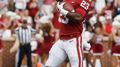 Oklahoma running back Abdul Adams (23) celebrates after scoring a touchdown during the second quarter an NCAA college football game in Norman, Okla., Saturday, Sept. 16, 2017. (AP Photo/Mitch Alcala)