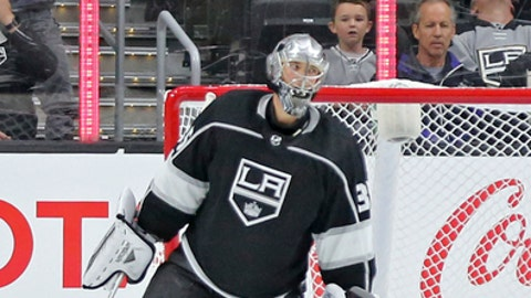 CORRECTS NAME TO DARCY KUEMPER- Los Angeles Kings goalie Darcy Kuemper sits in the goal after the Vancouver Canucks' Brock Boeser scored the winning goal in overtime in an NHL preseason hockey game in Los Angeles Saturday, Sept. 16, 2017. The Canucks won in overtime, 4-3. (AP Photo/Reed Saxon)