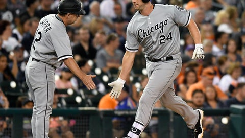 Chicago White Sox's Matt Davidson (24) is congratulated by third base coach Nick Capra (12) after hitting a home run against the Detroit Tigers in the fifth inning of a baseball game, Saturday, Sept. 16, 2017, in Detroit. (AP Photo/Jose Juarez)