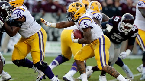 LSU running back Derrius Guice (5) follows his blockers as he tries to run past Mississippi State defenders during the first half of their NCAA college football game against in Starkville, Miss., Saturday, Sept. 16, 2017. (AP Photo/Rogelio V. Solis)