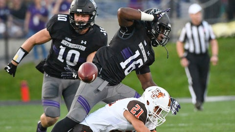 Northwestern linebacker Brett Walsh (10) and safety Godwin Igwebuike (16) defend against Bowling Green wide receiver Scott Miller (21) during the first half of an NCAA college football game in Evanston, Ill., Saturday, Sept. 16, 2017. (AP Photo/Matt Marton)