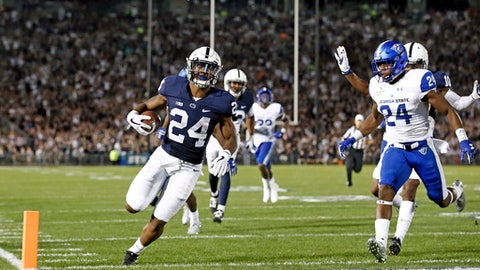 Penn State's Miles Sanders (24) runs in for a touchdown against Georgia State during the first half of an NCAA college football game in State College, Pa., Saturday, Sept. 16, 2017. (AP Photo/Chris Knight)